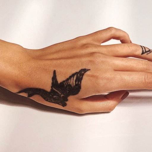 Have a Tattoo You Don't Like? Here's What You Should Know About Getting It Removed